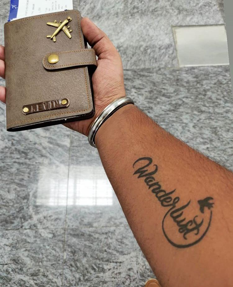 tattoo hand holding passport