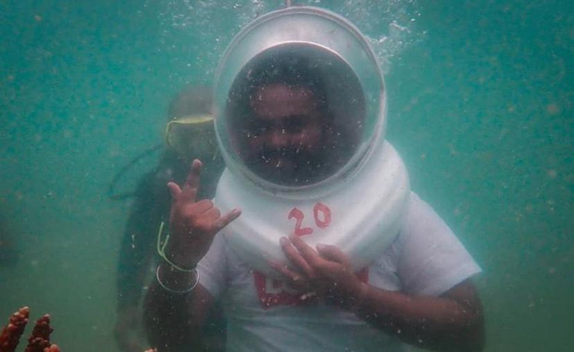 person underwater walking in pattaya